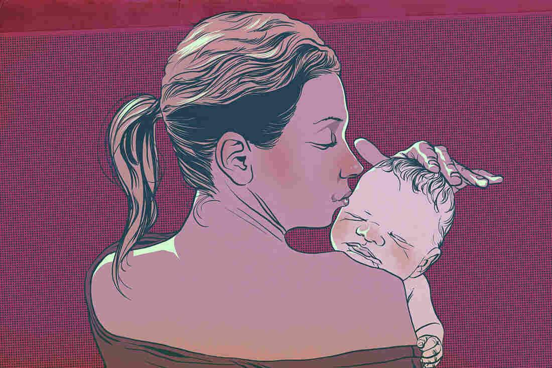 Mother caresses her newborn baby