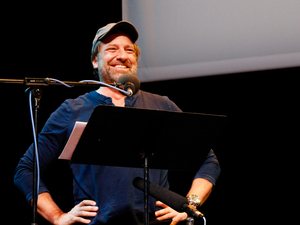 Mike Rowe on Ask Me Another at the Bob Carr Theater in Orlando, Florida.