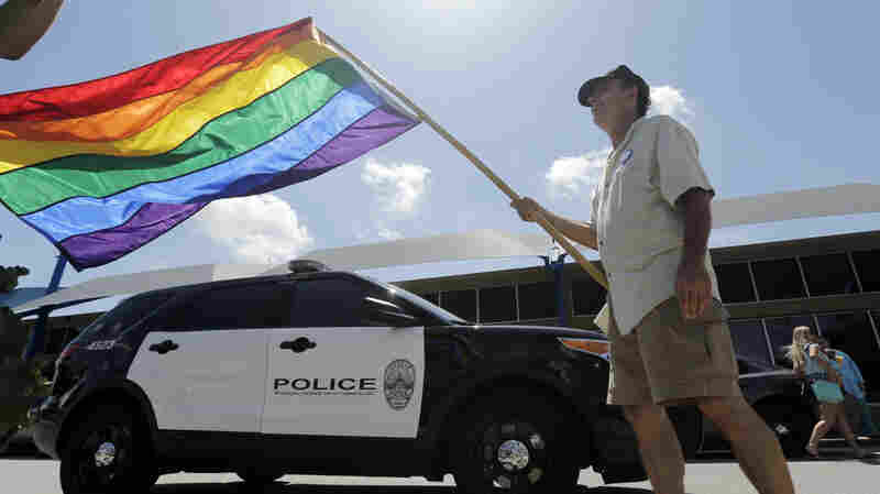 A man waves a rainbow flag in Austin, Texas, after the U.S. Supreme Court ruled same-sex couples have the right to marry.