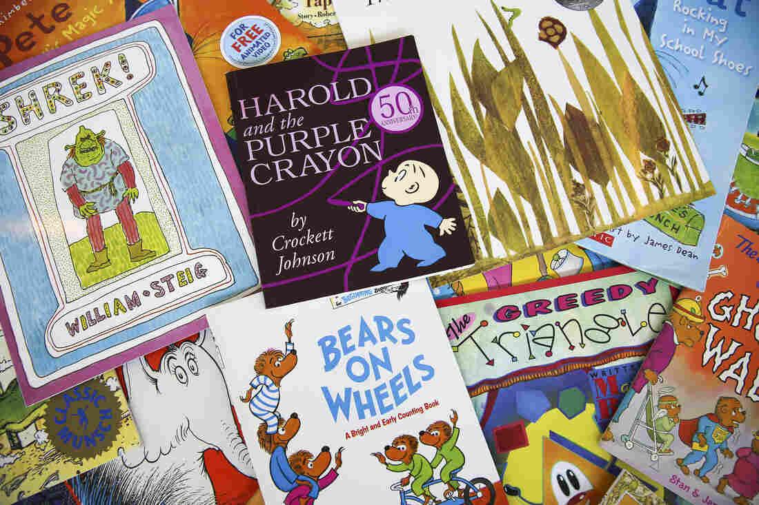 Children's books scattered on the floor