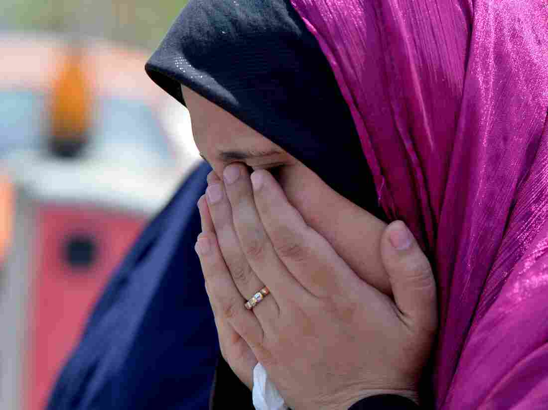 A relative of a passenger on the missing EgyptAir flight MS 804 cries at Cairo International Airport as she tries to receive information about the plane's fate.