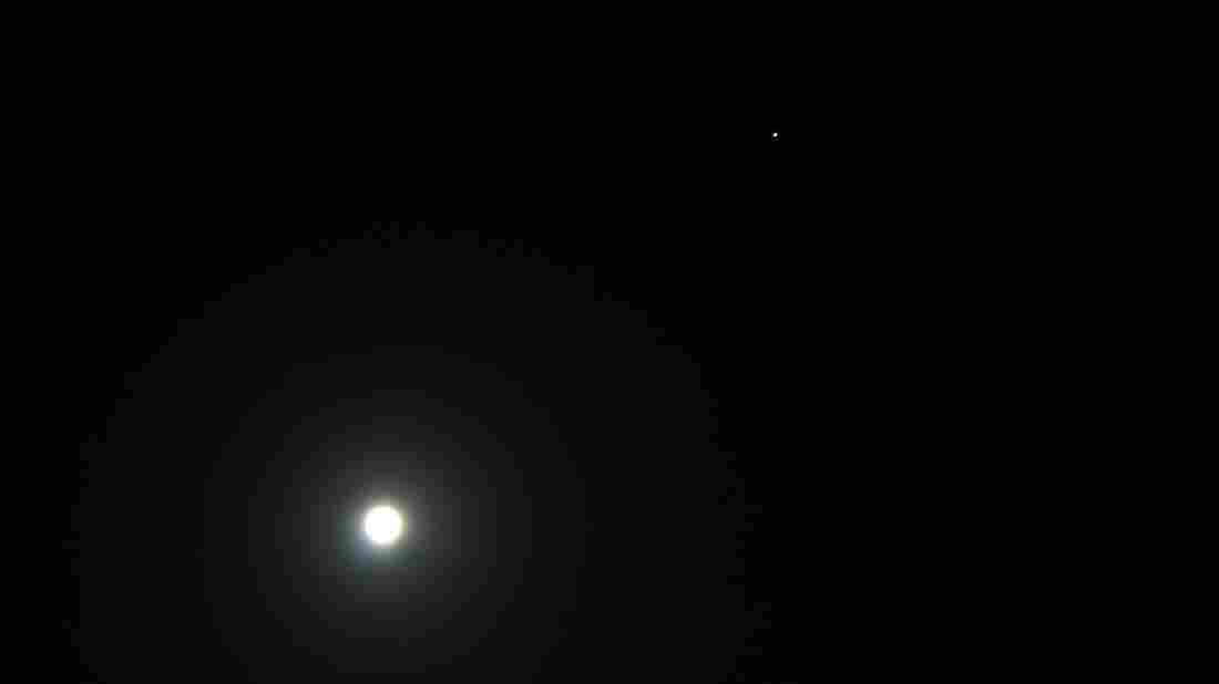 The moon and Mars, shown on Dec 24, 2007, during that year's Mars opposition. This year, Mars will be slightly closer to us than it was then but will look approximately the same — like a very bright, reddish star.