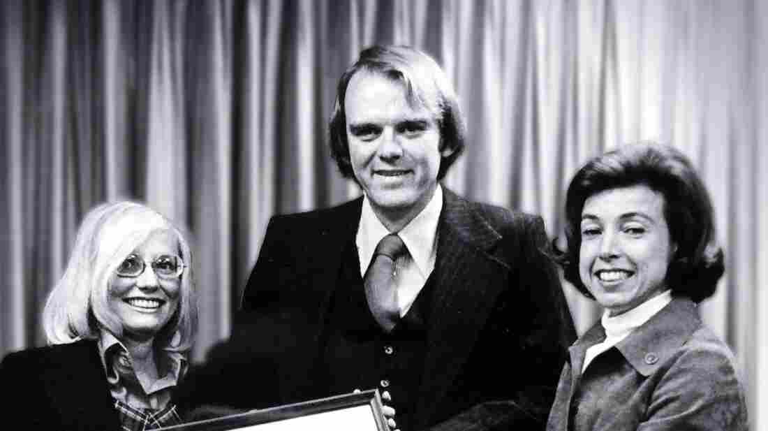 Bob Hunter became the Federal Insurance Administrator in 1976. On the right is the Secretary of Housing for Urban Development, Carla Hills, and on the left is his wife, Carole.