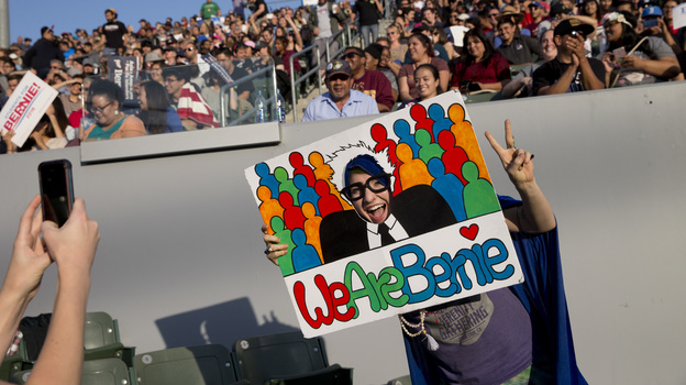 Brooke Peterson poses for photos with a sign at a rally for Democratic presidential candidate Sen. Bernie Sanders, I-Vt., on Tuesday in Carson, Calif. (AP)