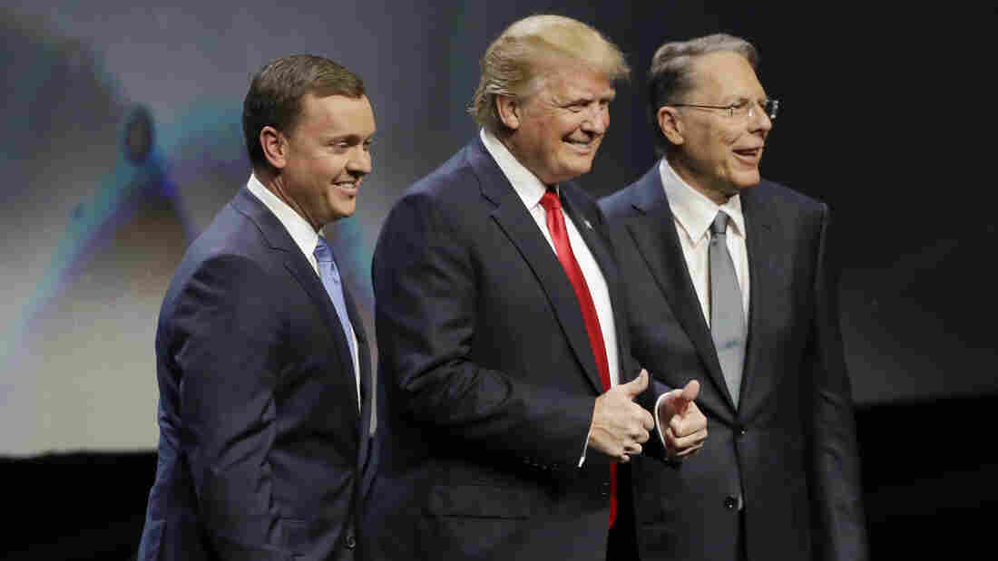 Donald Trump is introduced by National Rifle Association executive director Chris Cox (left) and NRA executive vice president Wayne LaPierre Friday at the organization's convention in Louisville, Ky.