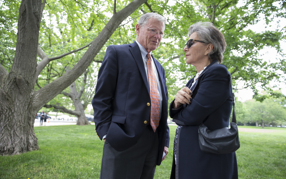 Environment and Public Works Committee Chairman Sen. James Inhofe, R-Okla., speaks with Sen. Barbara Boxer, D-Calif., on Thursday before joining a bipartisan group of senators at a Capitol Hill news conference to discuss legislation to improve the federal regulation of chemicals and toxic substances. (J. Scott Applewhite/AP)