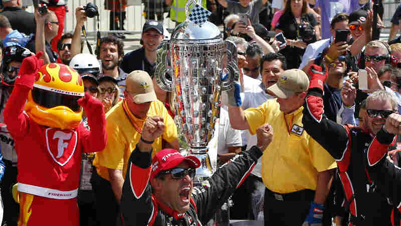 Juan Pablo Montoya of Colombia celebrates after winning last year's race. This year, for its 100th race, the Indianapolis 500 will bring back an official race-day poem.