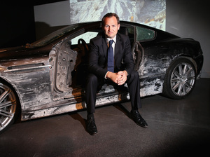 Ben Collins, who was the stunt driver for Daniel Craig, poses with the car from Quantum of Solace at the London Film Museum's Bond In Motion exhibit in March 2014.