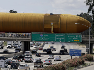 The last remaining space shuttle external propellant tank is moved across the 405 freeway in Los Angeles on Saturday. The ET-94 will be displayed with the retired space shuttle Endeavour at the California Science Center.