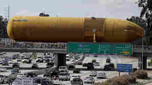A 66,000 Pound Space Shuttle Fuel Tank Parades Through Streets Of LA