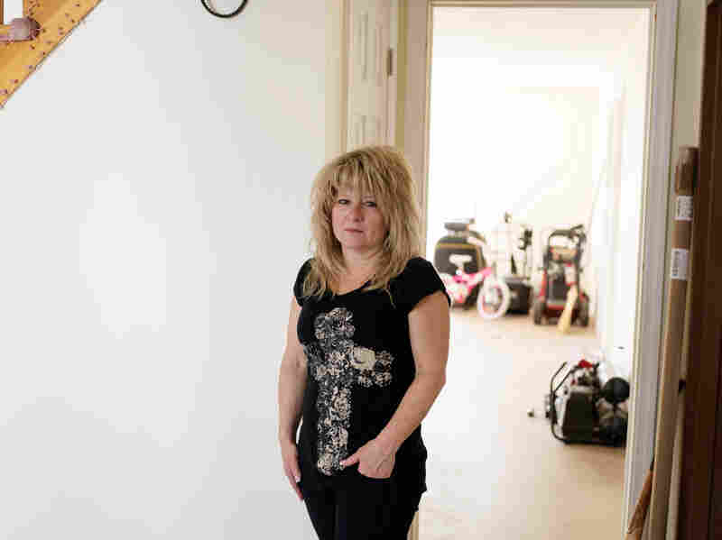 Diane Camerada stands inside her home on Staten Island, N.Y. She has been frustrated with the long bureaucratic process with the Build It Back program.