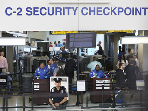 TSA agents work at a security checkpoint at Newark Liberty International Airport in New Jersey on Monday. The House committee says the head of security for TSA has been removed from his post after inquiries into the agency's management.