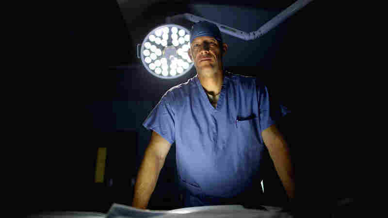 U.S. Air Force Lt. Col. Chance Henderson, an orthopedic surgeon, stands in the operating theater of the military hospital at Bagram Airfield in Afghanistan. Henderson is fighting to save the leg of a 6-year-old Afghan girl who was shot during a firefight between U.S. and Afghan forces and the Taliban.