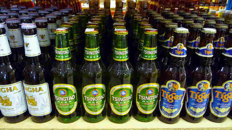 Chinese beer brands on display at a supermarket. An ancient brewery discovered in China's Central Plain shows the Chinese were making barley beer with fairly advanced techniques some 5,000 years ago.