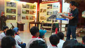 Nguyen Thanh Phu delivers a presentation to children on the dangers of active land mines and bombs in Dong Ha, Vietnam.