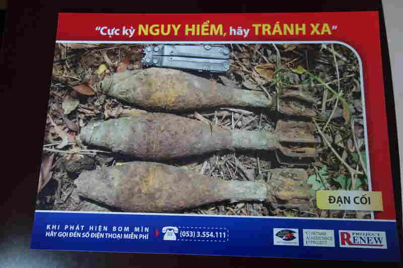 """A sign created by Project Renew shows mortar shells and warns, """"Extreme danger, keep out, stay away."""""""