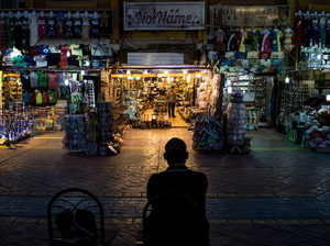A shop owner waits for customers in a market in the resort town of Sharm el-Sheikh, Egypt. Over the past nine months, tourism has plummeted in the country after a series of deadly attacks.