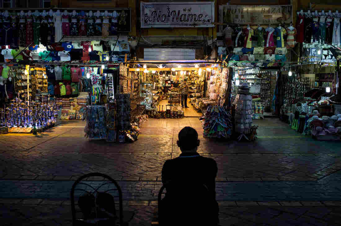 A shop owner waits for customers in a market in the resort town of Sharm El Sheikh, Egypt. Over the past nine months, tourism has plummeted in the country after a series of deadly attacks.
