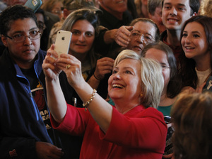 Hillary Clinton takes a selfie with campaign supporters after her address at a campaign rally at La Gala last week in Bowling Green, Ky.