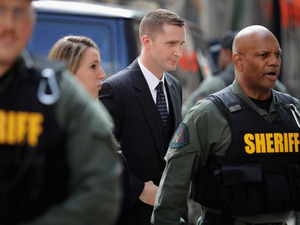 Officer Edward Nero (center) arrives at court in Baltimore on Monday. Nero has been found not guilty of multiple misdemeanor charges in the Freddie Gray case.