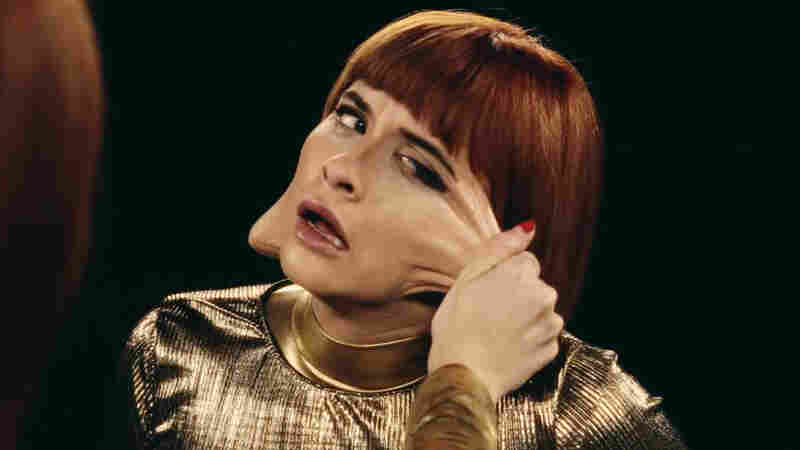 "Lucius singer, Jess Wolfe in a scene from the band's video for the song ""Gone Insane."""
