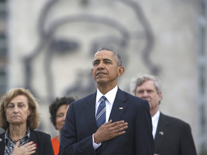 "President Obama listens to the U.S. national anthem in Havana, Cuba, on March 21. Behind him is an image of Cuba's revolutionary hero Ernesto ""Che"" Guevara."