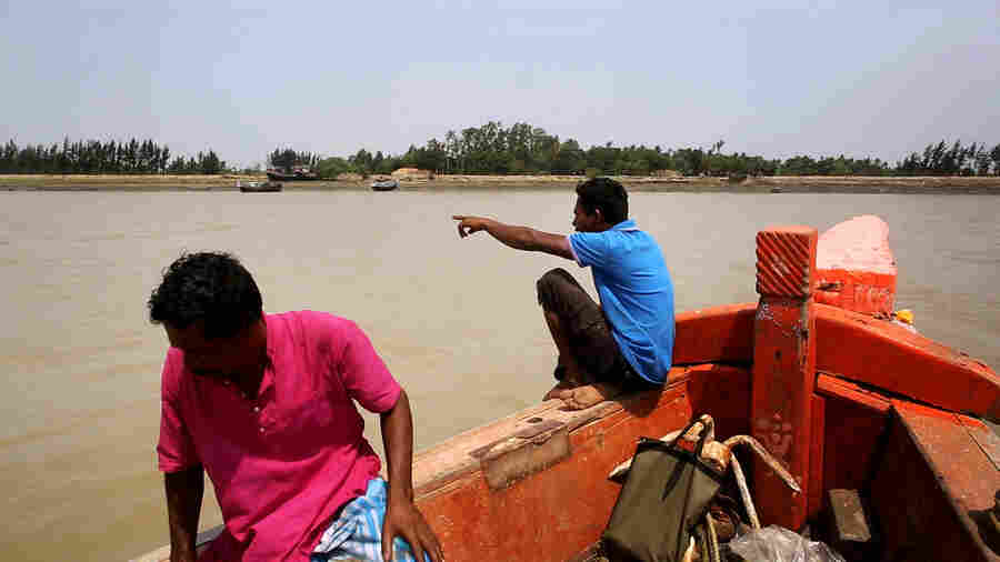 A boat approaches Ghoramara island in India's Sundarbans. Most traffic goes the other way, as thousands of Ghoramara residents have left the flood-prone island in recent years.