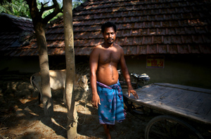 """Ratan Maity is a cart-puller who was resettled from Ghoramara to Sagar island 15 years ago, after he lost his house to rising tides. """"You can't defeat the water,"""" he says."""