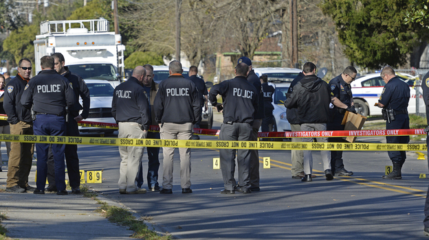 Officers investigate the scene of a shooting in Baton Rouge, La., in February. (AP)