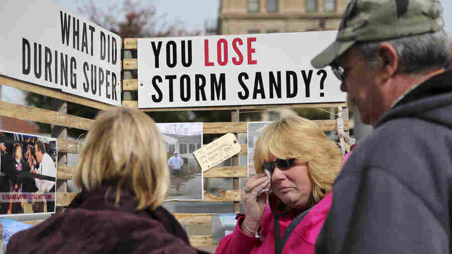 Sue Kenneally wipes tears as she and other victims of Superstorm Sandy gather during a demonstration across from the statehouse in Trenton, N.J., in October 2015. More than three years after the 2012 storm, many residents are still not back in their homes.