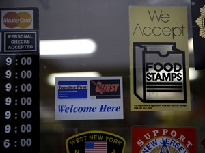 A supermarket displays stickers indicating they accept food stamps in West New York, N.J. (AP Photo/Seth Wenig)