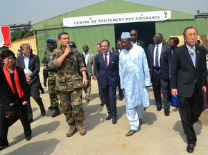 Margaret Chan (L), director general of the World Health Organization (WHO), Guinean President Alpha Conde (4th R), UN Secretary General Ban Ki-Moon (R) and Bertrand Cocheriez, French ambassador to Guinea, visit a military base in Conakry on December 20, 2014, during the UN chief's tour of west African countries hit by Ebola.