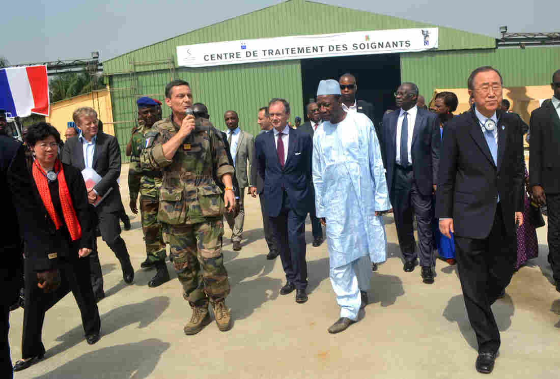 Margaret Chan (left), director general of the World Health Organization, is among the dignitaries visiting a military base in Conakry, Guinea, on a tour of west African countries affected by Ebola. Also pictured: Guinean President Alpha Conde (fourth from right) and U.N. Secretary General Ban Ki-Moon (right).