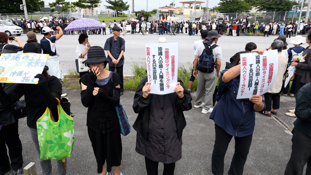 Demonstrators gather in a silent rally to mourn the death of an Okinawa woman in front of Camp Zukeran on May 22. The crime is thrusting the opposition to the U.S. presence on Okinawa back in the spotlight. (The Asahi Shimbun via Getty Images)
