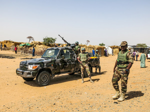 Soldiers patrol the sprawling Assaga refugee camp, which is home to thousands of people uprooted from their homes by Boko Haram attacks on both sides of the Nigeria-Niger border.