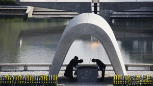 The mayor of Hiroshima and family of the deceased bow at the Hiroshima Memorial Cenotaph at Hiroshima Peace Memorial Park last year — the 70th anniversary of the bombing.