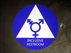 A new sticker designates a gender neutral bathroom at a high school in Seattle. President Obama's directive ordering schools to accommodate transgender students has been controversial in some places, leading 11 states to file a lawsuit against the Obama administration in response.