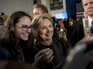 Hillary Clinton stops for a selfie with a supporter following a Women for Hillary Town Hall meeting with New York City.