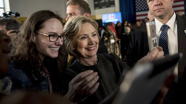 Hillary Clinton stops for a selfie with a supporter following a Women for Hillary Town Hall meeting in New York City. (Getty Images)