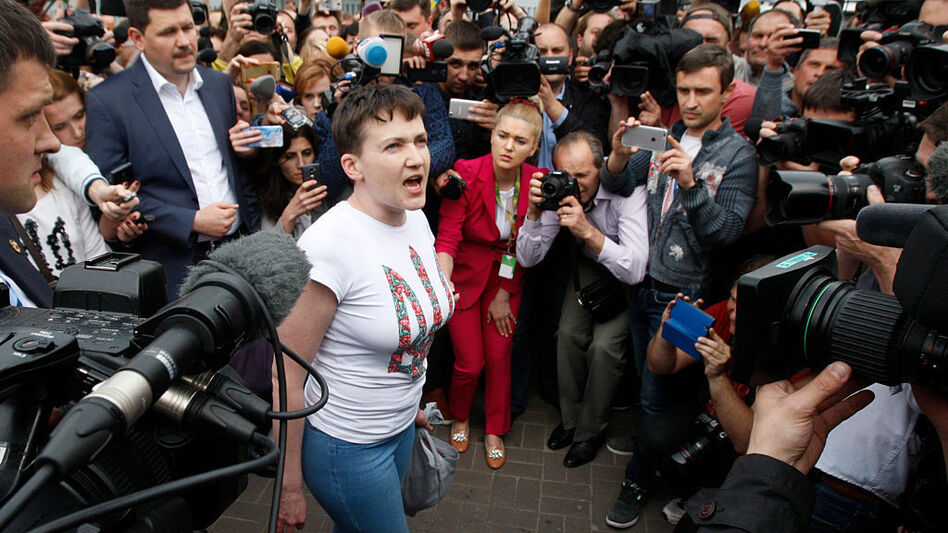 Ukrainian pilot Nadiya Savchenko (center), who was freed from jail in Russia as part of a prisoner exchange, talks to the media upon arrival at Kiev's Boryspil airport on Wednesday. (AFP/Getty Images)