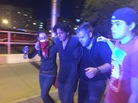 Protesters help a fellow demonstrator who was affected by the smoke and pepper spray reportedly used by police to disperse the crowd outside Tuesday's rally for Republican presidential candidate Donald Trump in Albuquerque, N.M.