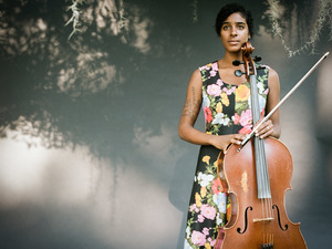 Leyla McCalla's latest album is A Day for the Hunter, a Day for the Prey.