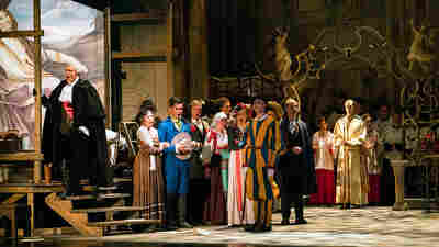 Michael Chioldi (far left) as Baron Scarpia in a January production of Puccini's Tosca by the newly reformed New York City Opera.