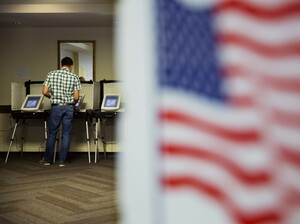 A voter casts a ballot at a polling site on May 24 in Atlanta.