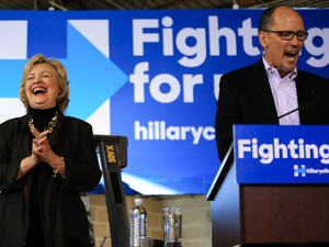 Hillary Clinton laughs as Labor Secretary Tom Perez endorses her during a campaign stop in Iowa on Dec. 4.
