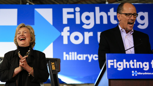 Hillary Clinton laughs as Labor Secretary Tom Perez endorses her during a campaign stop in Iowa on Dec. 4, 2015. (AP)