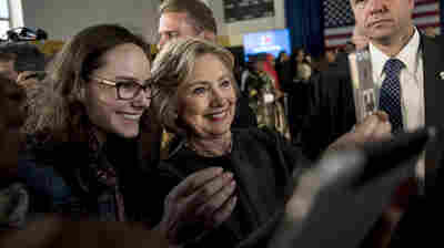 Hillary Clinton stops for a selfie with a supporter following a Women for Hillary Town Hall meeting in New York City.