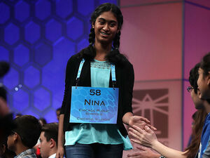 Nina Fonseca of Chicago, Illinois, celebrates with other spellers after a correct answer in round three of the 2016 Scripps National Spelling Bee.
