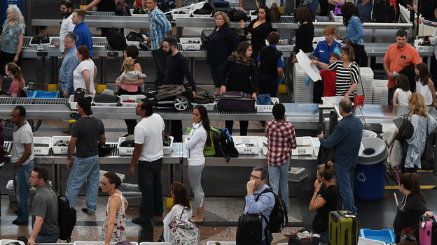Lines of travelers at Denver International Airport snake their way through security on Thursday. (Denver Post via Getty Images)