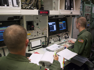 Members of the 320th Missile Squadron missile combat crew, work through a scenario in the 90th Operations Support Squadron's Missile Procedure Trainer on F.E. Warren Air Force Base, Wyo., in June 2014. The MPT is a simulator which allows missile crews to practice contingencies they might face while on alert.